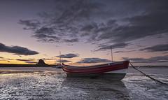 Lindisfarne light (Elidor.) Tags: sunrise holyisland lindisfarne northumberland northeast island castle boat faithful clouds morning dawn elidor d90