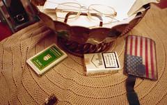 The life of a retired man (Minchioletta) Tags: glasses olympusstylusepic watch cellulare mobilephone eyeglasses cigarettes orologio playingcards occhiali sigarette kodakportra400 olympusmjuii cartedagioco analogicait lomographyandvintagecameras