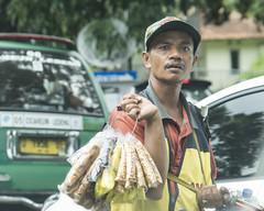 Pesky vendor, Bandung (Indigo Skies Photography) Tags: road street camera man colour car digital indonesia photography aperture exposure flickr traffic image iso photograph vehicle driver vendor roadside bandung westjava windscreen selling tamronsp2470mmf28divcusd nikond610