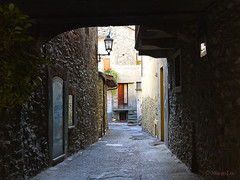 Romantic Streets ... (MargoLuc) Tags: street door light red italy backlight corner town shadows stones walk perspective romantic walls feeling picturesque aosta