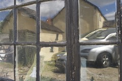 Reflections on a shed window - two (Stephen Toye) Tags: leica distortion reflection window glass shed frame rippled oldglass floatglass leicax2