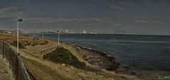 Cabo de Palos (cazador2013) Tags: mar paseo cielo azul rocas nubes edificios agua maritimo farolas
