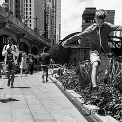 Kid's play (dharder9475) Tags: boy blackandwhite bw chicago kid day child play candid streetphotography running daytime 2016 peoplecandid privpublic