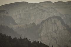 Barren peaks in the distance (Raoul Pop) Tags: autumn mountain fall stone season haze rocks cliffs romania evergreens ro barren highaltitude abrupt sinaia mountainpeaks muntenia
