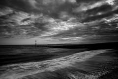 Solent Beach B&W. (muddlemaker1967) Tags: seascape beach water clouds blackwhite nikon surf dorset groyne d700