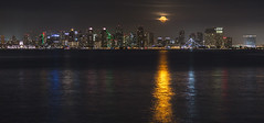 Partially Cloudy Full Moon Rises Over San Diego (slworking2) Tags: sandiego california unitedstates us moon full luna city skyline downtown water ocean reflection partiallycloudy