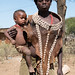 Tsemay village portrait: mother and child