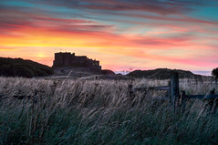 Bamburgh Castle at sunset (Andrew Kavanagh) Tags: bamburgh castle northumberland england historic sunset sky clouds skyporn bamburghcastle visitengland nikon