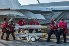 Sailors get a work out loading 500lb bombs onto F-18 jets conducting training (#PACOM) Tags: hurricanematthew storm gtmo meteorology weather shelter evacuation navy usnavy ussronaldreagancvn76 philippinesea uspacificcommand pacom