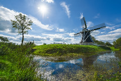 The last day of summer (Zoltan Acs) Tags: holland dutch thenetherlands windmill flat water pond canals green blue cloud sun sky nature scenery old tradition vivid outdoor travel walk landscape flatland sunstar