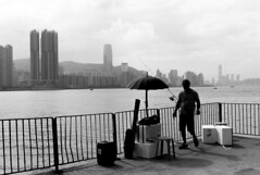 Umbrella, Shadows and Victoria harbor (Job Homeless) Tags: hongkong leiyuemun snap streetsnap streetphotography blackandwhite monochorme
