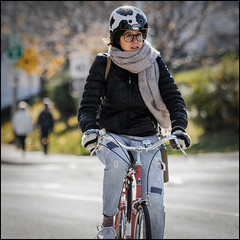 Bank Street October 23 2016 (Dan Dewan) Tags: centretown dandewan bicycle canon7dmarkii canonef70200mm14lisusm street canon lady colour woman october cyclist girl portrait sunday ottawa  eyes photographist ontario bankstreet glasses face bike 2016