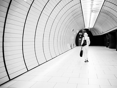walk through the subway station (Sandy...J) Tags: olympus monochrom fotografie mono women atmosphere atmosphre alone architektur allein architecture blackwhite bw black bavarian bayern light licht lines linien city deutschland einfarbig germany frau gehen photography street streetphotography sw schwarzweis strasenfotografie stadt urban ubahn underground subway station walk walking white wall wand munich mnchen