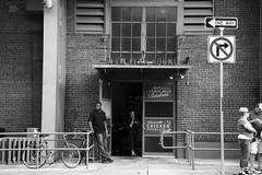 Open Year Round (peterkelly) Tags: bw usa bike bicycle sign boston digital us unitedstates baseball stadium massachusetts unitedstatesofamerica northamerica oneway railing fenwaypark bostonredsox chickennoodlesoup cornedbeef mlb norightturn lansdownestreet
