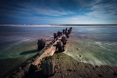 Folly beach -EXPLORED (Riddhish Chakraborty) Tags: longexposure seascape beach nature horizontal pier tide folly 2014 longshutterspeed colorimage