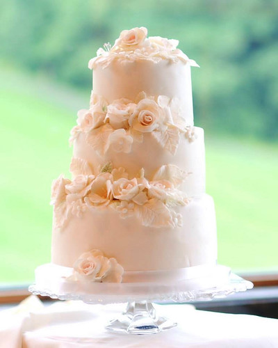 """A gorgeous white on white wedding cake. • <a style=""""font-size:0.8em;"""" href=""""http://www.flickr.com/photos/50891271@N03/16159426868/"""" target=""""_blank"""">View on Flickr</a>"""