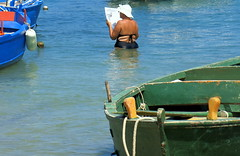 Reading newspaper in the water (loungerie) Tags: sea summer italy woman hot green water hat painting relax reading boat newspaper seaside italian san italia mare fat read fatty summertime puglia vito sanvito hopperesque