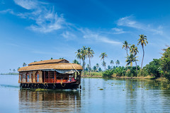 Houseboat on Kerala backwaters, India (Dmitry Rukhlenko Travel Photography) Tags: travel cruise sunset india tree tourism water ferry river asian outside outdoors boat canal asia day sailing ship outdoor indian traditional transport floating houseboat vessel kerala tourist palm canals transportation tropical leisure watercraft backwaters scenics attraction backwater southindia watertransportation traveldestination outdoorshot