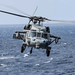 MH-60S helicopter takes off from the flight deck of the USS Ashland