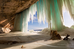 Cavern behind ice curtains on Grand Island on Lake Superior (Craig - S) Tags: travel winter sea wild usa lake snow cold tourism nature water beauty rock clouds landscape coast frozen nationalpark log colorful natural outdoor cove michigan scenic freezing peaceful greatlakes coastal stump icicle coastline cave serene wilderness upperpeninsula cavern lakesuperior icicles munising grandisland picturedrocks seacave naturalarea picturedrocksnationallakeshore nationallakeshore icecurtains geologicalformation