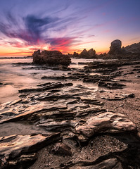 Newport Beach (meeyak) Tags: ocean california longexposure travel sunset summer vacation usa seascape texture beach vertical night landscape nikon rocks warm dusk rocky newportbeach adventure socal newport slowshutter southerncalifornia orangecounty oc coronadelmar cdm ndfilter 1635mm longexpo littlecorona meeyak