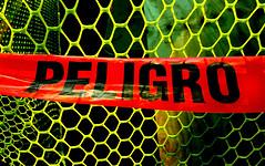 f_peligrotape (ricksoloway) Tags: signlanguage warningsigns direwarnings tucsonarizona arizonamojo cameraphone