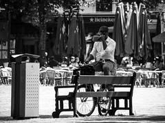 Inge Hoogendoorn (ingehoogendoorn) Tags: denhaag thehague thenetherlands plein hetplein drinking drink bike dutchbikes dutchbike blackandwhite blacknwhite monochrome monochromatic monochroom streetphotography straatfotografie streetscene heineken contrast people peopleonthestreet