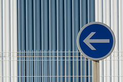 This way (Jan van der Wolf) Tags: map158274v sign roadsign trafficsign dof depthoffield hek fence lines lijnen lijnenspel interplayoflines playoflines verkeersbord arrow composition compositie oneway onewaysign blue blauw