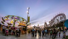 Cliff Hanger (matman73072) Tags: santacruz boardwalk amusementpark rides rollercoaster giantdipper flatride spinner crowd sunset bluehour fisheye motionblur