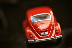 Heading home for the weekend... (eleni m) Tags: car toy red speelgoedauto vw volkswagen kever beetle outdoor weekend happy dof darkbackground home thuis