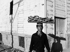 Simitci (Orkun Karaburun) Tags: portrait bw bread portre simit simitci