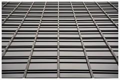 Cuadrcula (albertpuiggrosvega) Tags: barcelona sky lines buildings edificios nikon shadows squares bcn cielo sombras banc reflejos lineas sabadell ciudadcondal cuadrados cuadrcula d7100