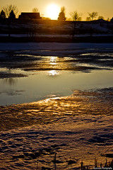 Ice Sunset (B.jamison Photo) Tags: blue light sunset sky orange brown sun white snow black cold tree ice water canon march pond bright round t3i