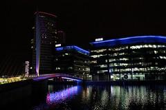 Salford Quays / BBC (rreyn92) Tags: city bridge blue colour reflection building tree water night buildings dark manchester lights media salfordquays nighttime bbc colourful salford ref mediacity mediacityuk