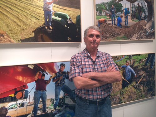 "Photographer John R van Beekum at his exhibition called ""More Land than People"" at the University of Miami gallery in Wynwood"