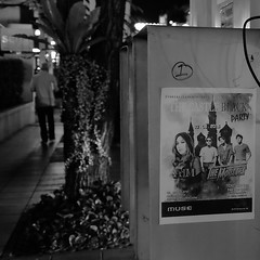 The Mousses (jcbkk1956) Tags: poster street fuji xt1 thonglo bangkok thailand man walking mono blackwhite fujinonxf18135mm night phonebooth streetfurniture dof