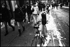 one day in chinatown (-{ ThusOriginal }-) Tags: 135 28mm bw bicycle bike blackandwhite city f3t film fujineopan1600 monochrome nyc parkingmeter people snow street thusihaveseen winter thusoriginal newyork scan