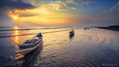 Deserted (abhishek.deopurkar) Tags: sky sea sunset water boat beach blue clouds coast ocean waves summer boats evening peaceful pink seascape tide rays ray colorful dusk flowing pastel delight indianocean landscape