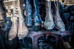 Boots in shoemaker shop @ Oudewater (PaulHoo) Tags: oudewater city urban 2016 summer still boots shoemaker shop window store interior reflection vignette vignetting holland netherlands nikon d700