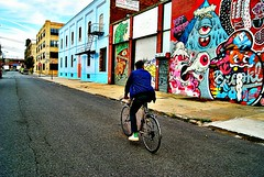 "Cycling past graffiti art in Brooklyn. • <a style=""font-size:0.8em;"" href=""http://www.flickr.com/photos/39036397@N02/15523647423/"" target=""_blank"">View on Flickr</a>"