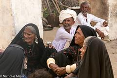 At The Saang Wari Fair (Nick Mayo/RemoteAsiaPhoto) Tags: india festival headscarf earring bracelet turban gujarat rabari ratanpar