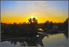 Puesta  de  sol   desde puente  romano (ferlancor) Tags: sunset andaluca guadalquivir crdoba ocaso reflejos