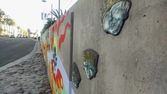 Public art on wall (EllenJo) Tags: california ca mural sandiego publicart february harbordrive 2015 ellenjo glassfaces neartheconventioncenter ellenjoroberts