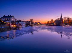 Old town winter (Micke66) Tags: old houses winter sunset ice church water river town sweden eskilstuna