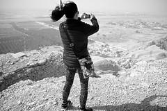 I'm starting to see a bigger picture* (Kyre Wood) Tags: bw woman mobile landscape mono hill kingdom windy saudi arabia