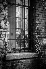 Caged in the Revolver (WestCoasting) Tags: street monochrome vancouver alley coffeeshop canon5d revolver gastown cambie cambiestreet