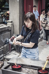 The Temple (DiagonSally) Tags: china travel portrait woman tourism girl lady female asian temple asia candle chinese culture tourist hong kong burning macau incense