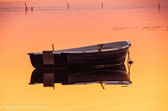 Floating (Francesco Impellizzeri) Tags: sunset seascape water reflections landscape boat sicilia trapani