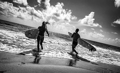 Day at the Beach. (pmpiasecki) Tags: ocean people blackandwhite beach water monochrome clouds blackwhite surf waves monotone surfing ricohgr