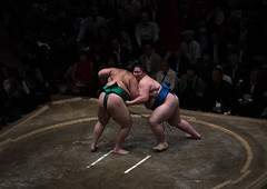 Two sumo wrestlers fighting at the ryogoku kokugikan arena, Kanto region, Tokyo, Japan (Eric Lafforgue) Tags: people male men sport japan horizontal asian japanese tokyo big fight asia fighter power martial wrestling fat traditional champion culture traditions lifestyle competition clash ring east indoors tournament ritual leisure sumo inside strength fullframe athlete adults wrestlers adultsonly cultural obese overweight ryogoku 3people competitors kantoregion threepeople colourpicture 2029years japan161083